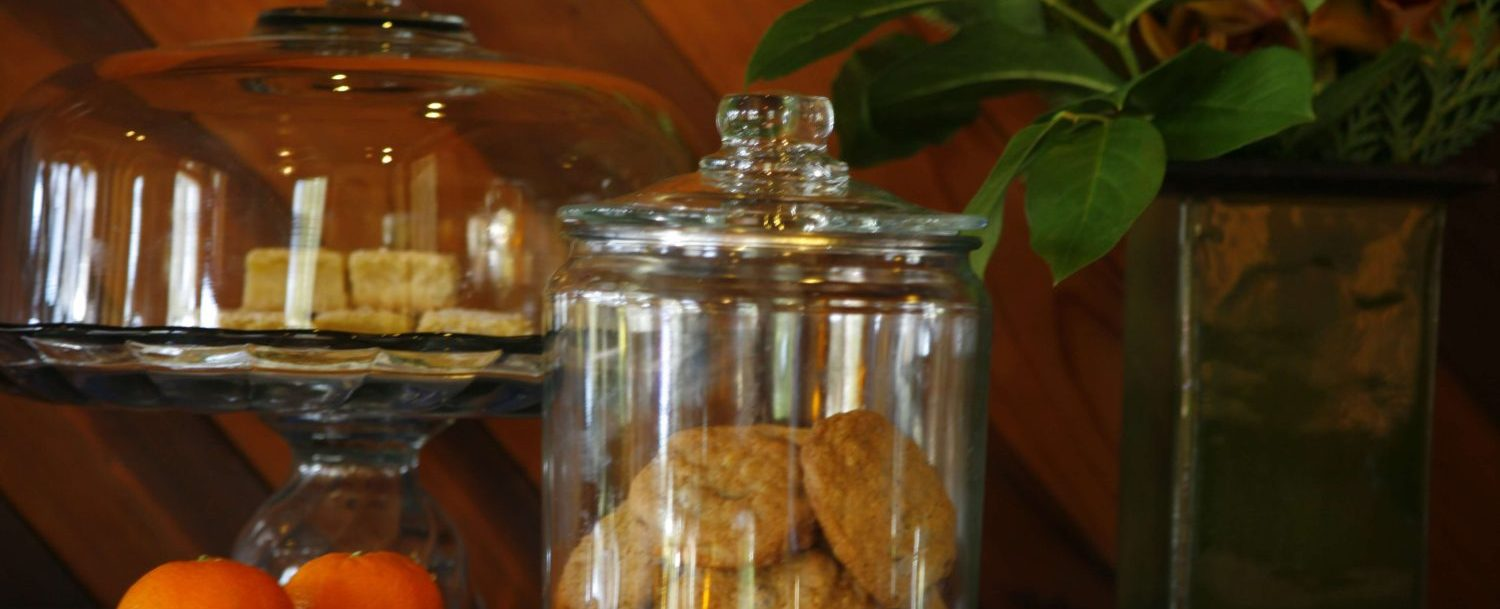 Cookie jar and tangerines on table