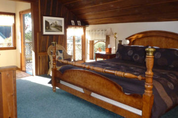 Tree House room - large bed, chair, nightstand