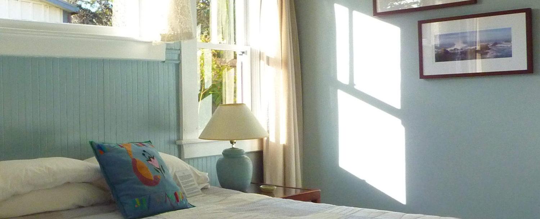 West room bed, nightstand, window