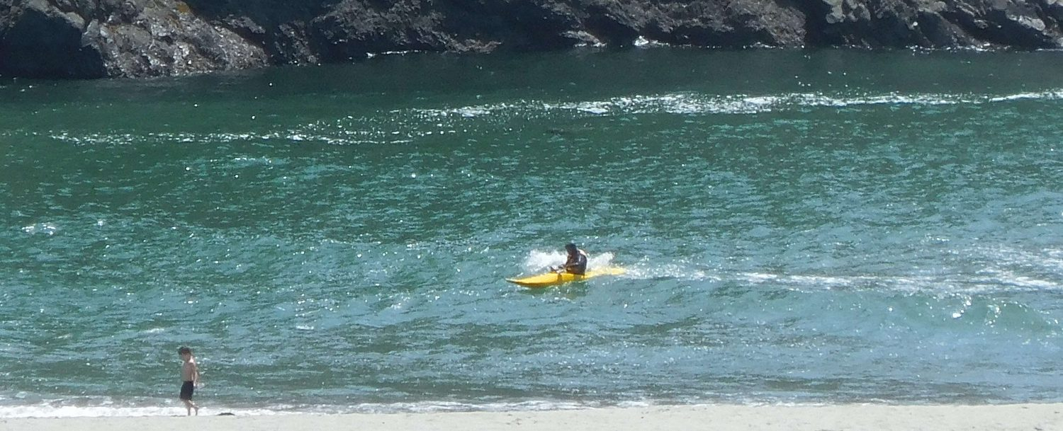 Kayaker Surfing Big River Beach